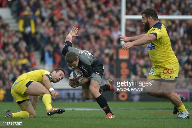 Toulouse's French scrum-half Antoine Dupont breaks away during the French Top 14 rugby union match Toulouse against Clermont on April 14, 2019 at the...
