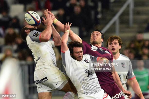 TOPSHOT Toulouse's French scrumhalf JeanMarc Doussain and Toulouse's French fullback Maxime Medard vie with BordeauxBegles' French fullback Nans...