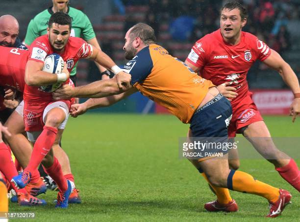 Toulouse's French scrum-half Sebastien Bezy is tackled by Montpellier's Georgian prop Levan Chilachava during the European Cup rugby union pool match...