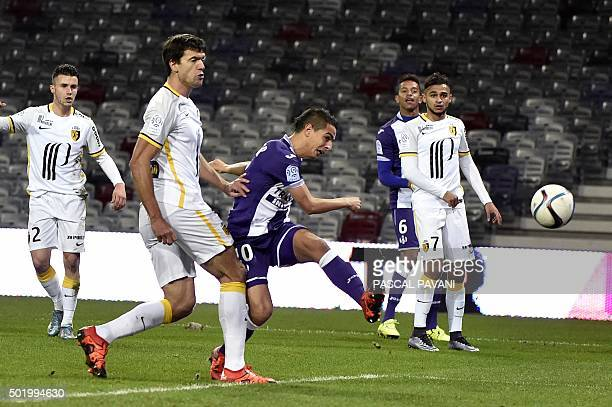 Toulouse's French Tunisian forward Wissam Ben Yedder shoots and scores a goal during the French L1 football match between Toulouse and Lille on...