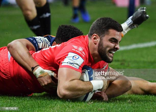 Toulouse's French wing Lucas Tauzin scores a try during the European Rugby Champions Cup rugby union match between Montpellier and Toulouse on...