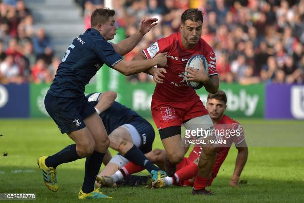 Toulouse's French wing Sofiane Guitoune vies with Leinster's Irish player Jordan Larmour during the European Rugby Champions Cup rugby union match...