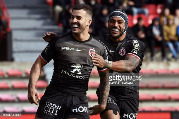 Toulouse's French winger Sofiane Guitoune celebrates with teammate Toulouse's New Zealand centre Pita Ahki after scoring a try during the French Top...