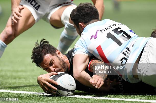 Toulouse's French winger Sofiane Guitoune scores a try during the French Top 14 rugby union match between Racing 92 vs Toulouse on February 17 2019...