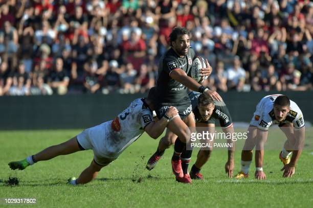 Toulouse's French winger Yoann Huget collapses with La Rochelle's French centre Brieuc Plessis-Couillaud during the French Top 14 rugby union match...