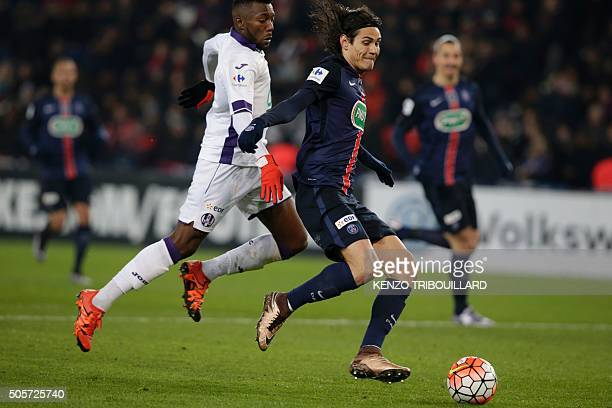 Toulouse's FrenchBurkinabe defender Steeve Yago vies with Paris SaintGermain's Uruguayan forward Edinson Cavani during the French Cup football match...