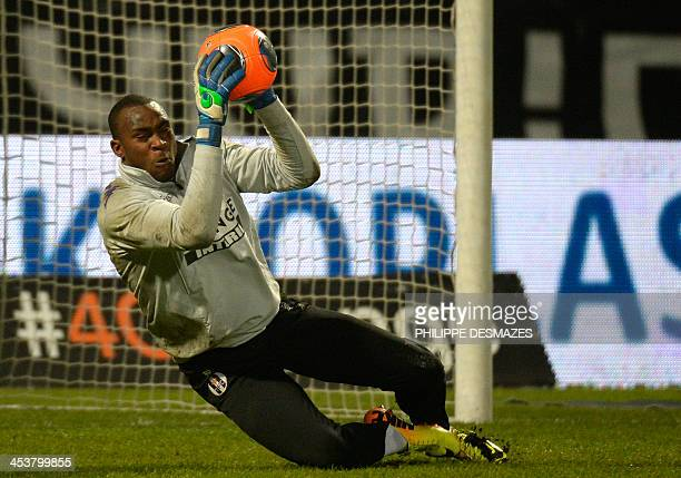 Toulouse's Guinea goalkeeper Issiaga Sylla catches the ball as he trains before the French Ligue 1 football match Olympique Lyonnais vs Toulouse FC...
