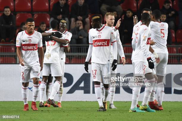 Toulouse's Guinean defender Issiaga Sylla celebrates after scoring a goal during the French League Cup football match between Rennes and Toulouse on...