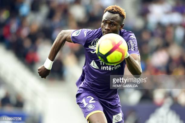 Toulouse's Guinean defender Issiaga Sylla controls the ball during the French L1 football match between Toulouse and Guingamp on March 10 at the...