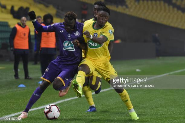 Toulouse's Guinean defender Issiaga Sylla fights for the ball with Nantes' Belgian forward Anthony Limbombe during the French Cup round of 16...