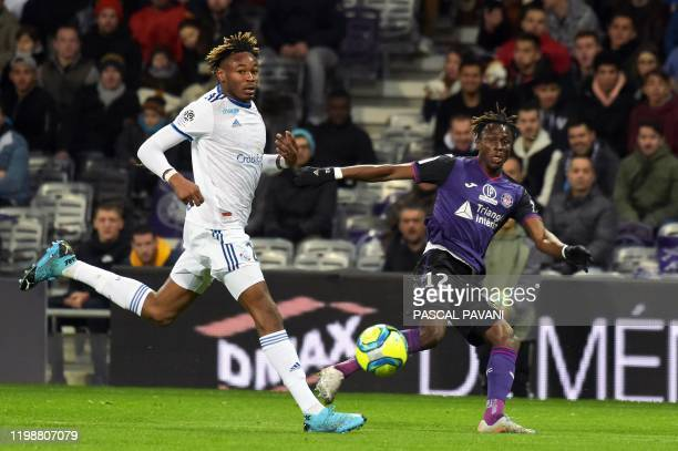 Toulouse's Guinean defender Issiaga Sylla vies with Strasbourg's French defender Mohamed Simakan during the French L1 football match between Toulouse...
