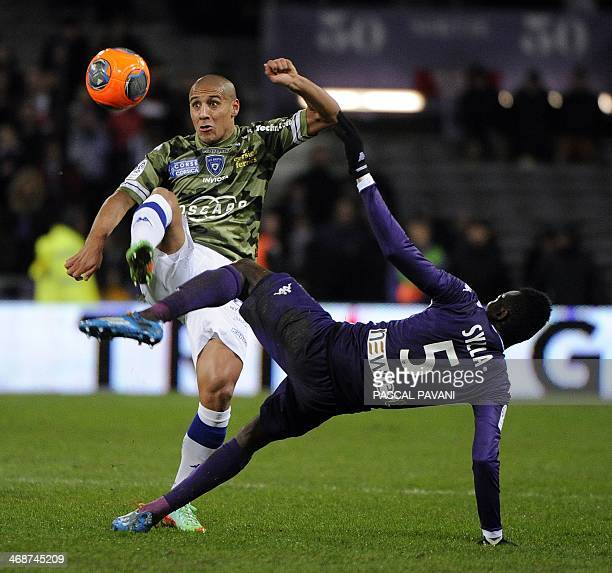 Toulouse's Guinean midfielder Issiaga Sylla vies with Bastia's Tunisian midfielder Wahbi Khazri during the French L1 football match Toulouse against...