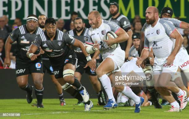 Toulouse's hooker Leonardo Ghiraldini runs with the ball during the French Top14 rugby union match CA Brive versus Toulouse on September 23 2017 at...