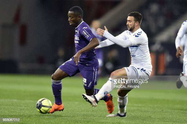Toulouse's Ivorian forward Max Gardel vies with Strasbourg's French midfielder Pablo Martinez during the French L1 football match between Toulouse...
