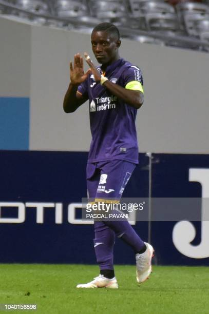 Toulouse's Ivorian forward MaxAlain Gradel celebrates after scoring a goal during the French L1 football match between Toulouse and Saint Etienne on...