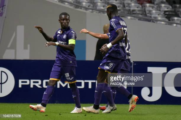 Toulouse's Ivorian forward Max-Alain Gradel celebrates after scoring a goal during the French L1 football match between Toulouse and Saint Etienne on...
