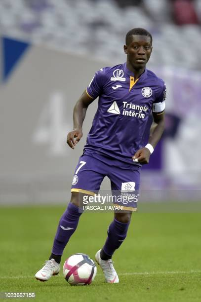 Toulouse's Ivorian forward MaxAlain Gradel controls the ball during the French L1 football match between Toulouse and Nimes on August 25 2018 at the...