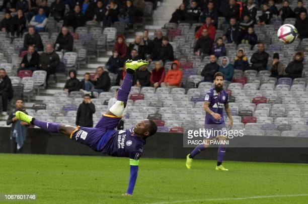 Toulouse's Ivorian forward MaxAlain Gradel scores a goal during the French L1 football match between Toulouse and Dijon on December 2 2018 at the...