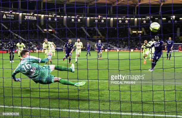TOPSHOT Toulouse's Ivorian forward MaxAlain Gradel scores a penalty kick past Angers' French goalkeeper Ludovic Butelle during the French L1 football...