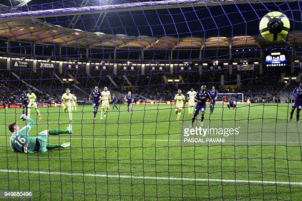 Toulouse's Ivorian forward MaxAlain Gradel scores a penalty kick past Angers' French goalkeeper Ludovic Butelle during the French L1 football match...