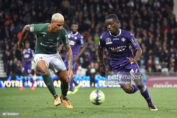 Toulouse's Ivorian forward MaxAlain Gradel vies for the ball with SaintEtienne's French defender Leo Lacroix during the French L1 football match...