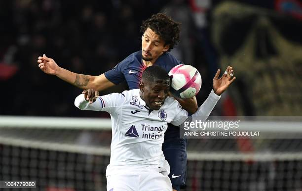 Toulouse's Ivorian forward MaxAlain Gradel vies with Paris SaintGermain's Brazilian defender Marquinhos during the French Ligue 1 football match...