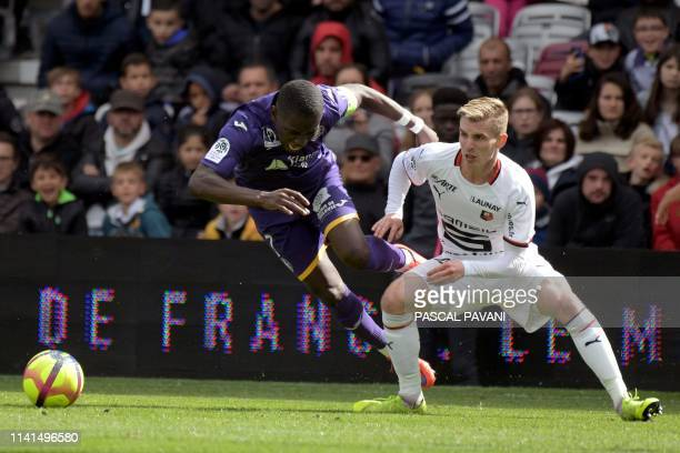 Toulouse's Ivorian forward MaxAlain Gradel vies with Rennes French midfielder Benjamin Bourigeaud during the French L1 football match between...