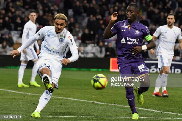 Toulouse's Ivorian forward MaxAlain Gradel vies with Strasbourg's French defender Kenny Lala during the French L1 football match between Toulouse and...
