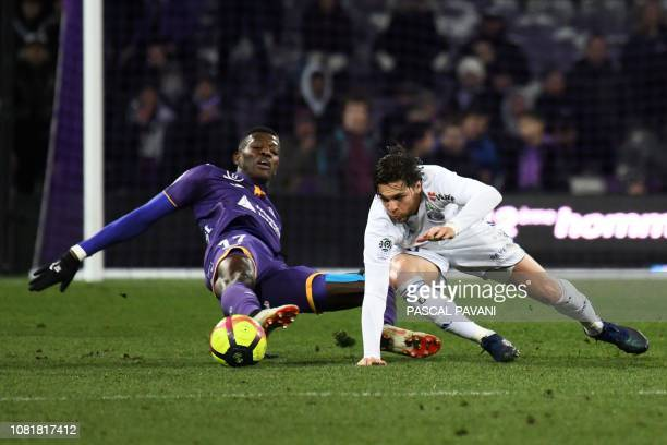 Toulouse's Ivorian midfielder Ibrahim Sangare vies with Strasbourg's French midfielder Jonas Martin during the French L1 football match between...