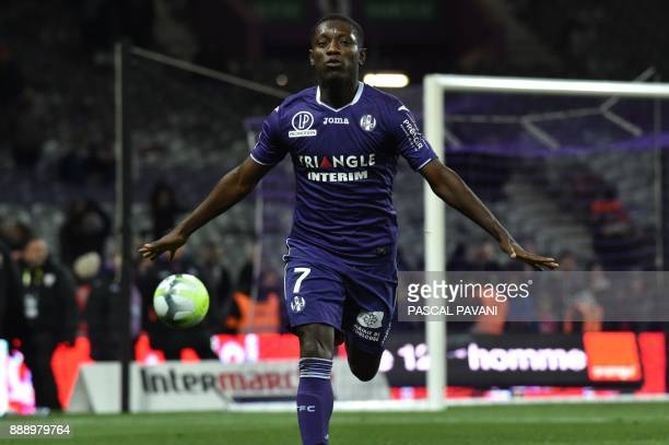 Toulouse's Ivory Coast forward MaxAlain Gradel celebrates after scoring a goal during the French L1 football match Toulouse vs Caen on December 9...