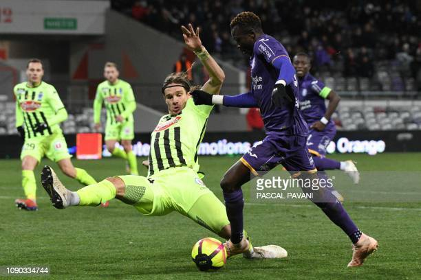 Toulouse's Ivory Coast midfielder Ibrahim Sangare vies for the ball against Angers Croatian defender Mateo Pavlovic during the French L1 football...