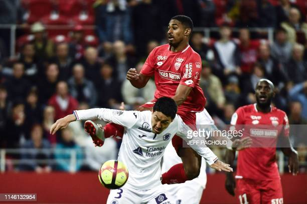 Toulouse's Japanese defender Gen Shoji vies with Dijon's French forward Wesley Said during the French L1 football match between Dijon and Toulouse on...