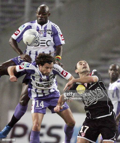 Toulouse's midfielder Achille Emana and Gilles Sireix vies with Nancy's forward Carlos Curbelo during their French L1 football match Toulouse FC vs...