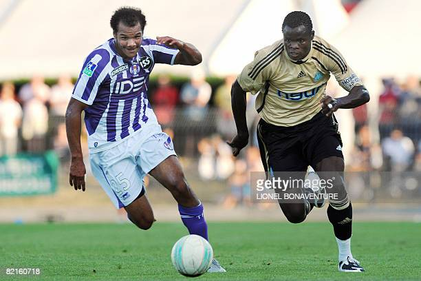 Toulouse's midfielder Daniel Braaten vies with Marseille Taye Ismaila during the friendly football match Toulouse vs. Marseille, in Albi, southern...