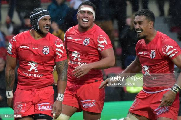 Toulouse's New Zealand centre Pita Ahki celebrates with teammates after scoring a try during the European Champions Cup rugby union pool match...