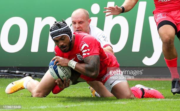 Toulouses New Zealand centre Pita Ahki scores a try during the European Champions Cup quarterfinal rugby union match between Stade Toulousain and...