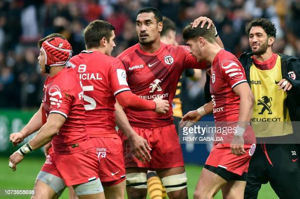 Toulouse's New Zealand flanker Jerome Kaino jubilates with Toulouse's French centre Romain Ntamack after he scores a try during the European...