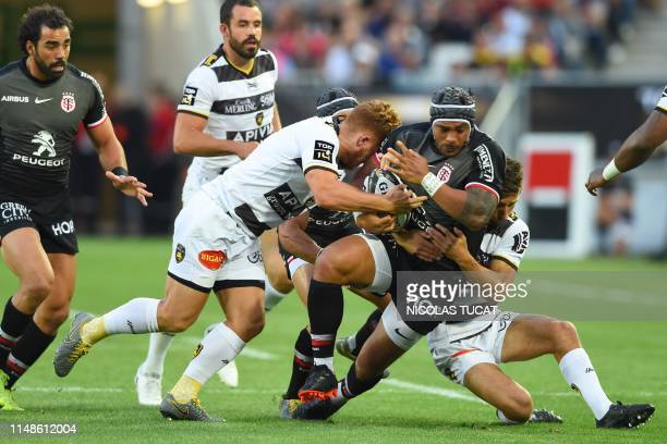 Toulouse's New Zealander center Pita Ahki is tackled during the French Top 14 semifinal rugby union match between Toulouse and La Rochelle on June 8...
