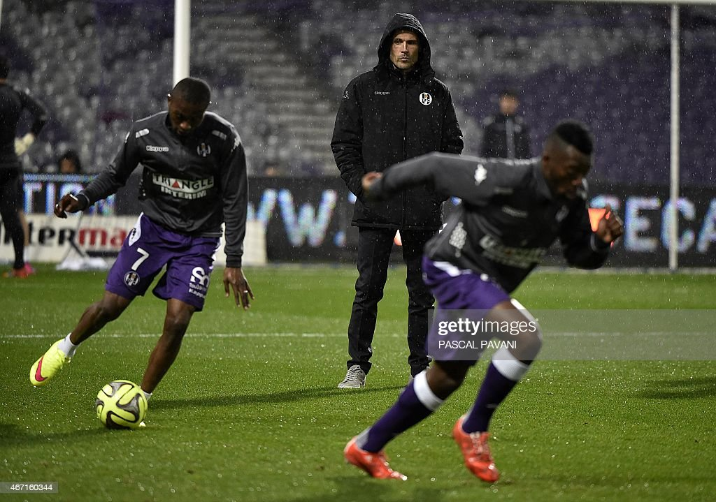 Toulouse's newly appointed head coach Dominique Arribage look at his players warming up before the French L1 football match Toulouse vs Bordeaux on March 21, 2015 at the Municipal Stadium in Toulouse.