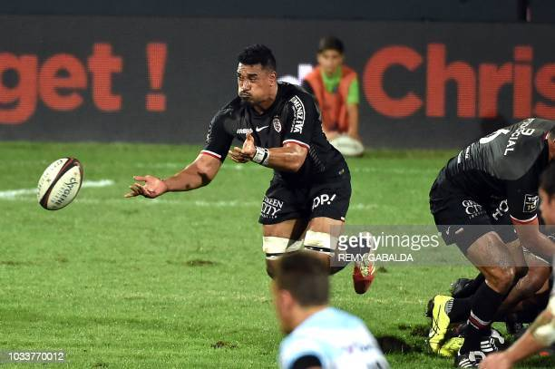Toulouse's number eight Jerome Kaino passes the ball during the French Top 14 rugby union match between Toulouse and Racing 92 at Ernest Wallon...
