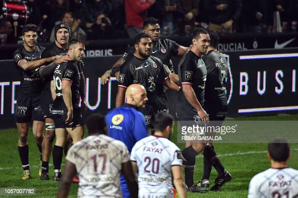 Toulouse's players celebrate after scoring a try during the French Top 14 rugby union match between Toulouse and BordeauxBegles at the Ernest Wallon...