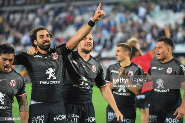 Toulouse's players celebrate after winning the French Top 14 semifinal rugby union match between Toulouse and La Rochelle on June 8 2019 at the...