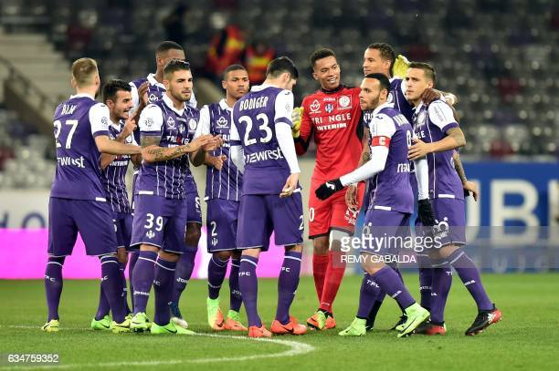 Toulouse's players congratulate their teammate Martin Braithwaite after he scored a goal during the French L1 Football match between Toulouse and...