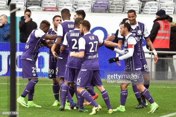 Toulouse's players react after their captain Martin Braithwaite scored a goal during the French L1 football match between Toulouse and Angers on...