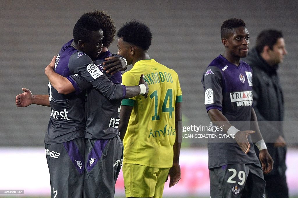 Toulouse's players react at the end of the French L1 football match between Nantes (FCN) and Toulouse (TFC) on December 2, 2014 at the Beaujoire stadium in Nantes, western France.