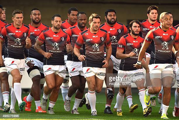 Toulouse's players warm up before the French Top 14 rugby union match between Montpellier and Toulouse at the Altrad stadium in Montpellier south of...