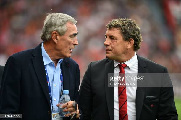 Toulouse's president Didier Lacroix chats with Castres's president PierreYves Revol during the French Top 14 rugby union match between Stade...