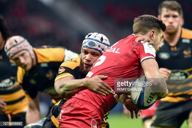 TOPSHOT Toulouse's Romain Ntamack is tackled by Wasps's flanker Ben Moris during the European Champions Cup pool one rugby union match between...