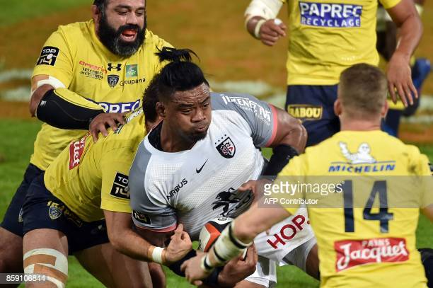 Toulouse's Samoan lock Iosefa Tekori is tackled during the French Top 14 rugby union match Stade Toulousain vs Clermont Auvergne at the ErnestWallon...