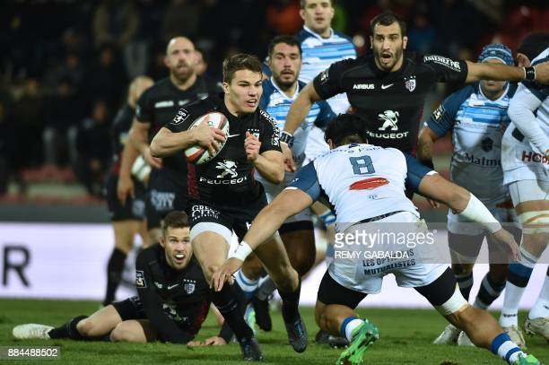 Toulouse's scrum half Antoine Dupont runs with the ball during the French Top 14 rugby union match between Toulouse and Castres at the Ernest Wallon...